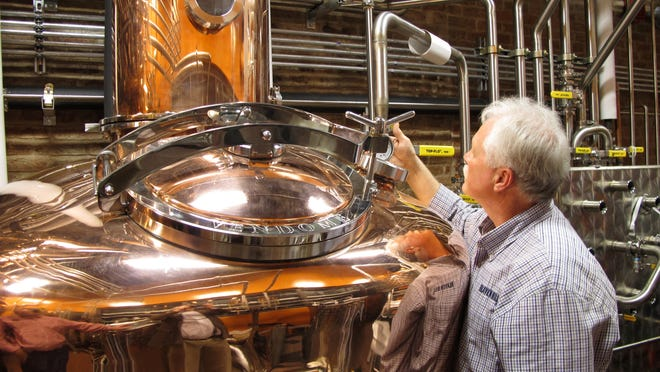 Charlie Downs, the craft distiller at the Evan Williams Bourbon Experience in downtown Louisville, checks gauges on a still that will produce small batches of whiskey.