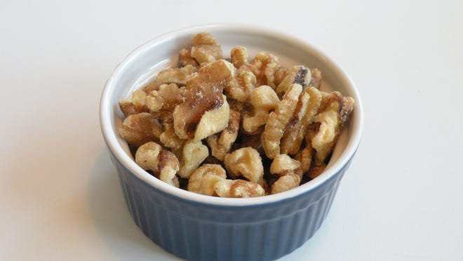 Walnuts contain omega-3 fatty acids, antioxidants, protein and fiber. They are heart healthy and can help to lower LDL, or bad, cholesterol when eaten in moderation.