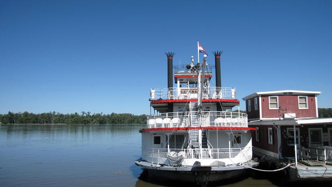 A riverboat docks in Hannibal, Missouri, on the Mississippi River. Many of his writings were inspired by his memories of Hannibal and the river.