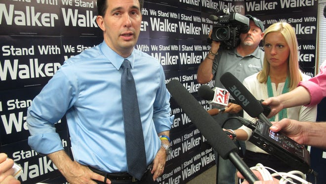 Wisconsin Gov. Scott Walker talks to reporters in Madison on Aug. 29, 2014.