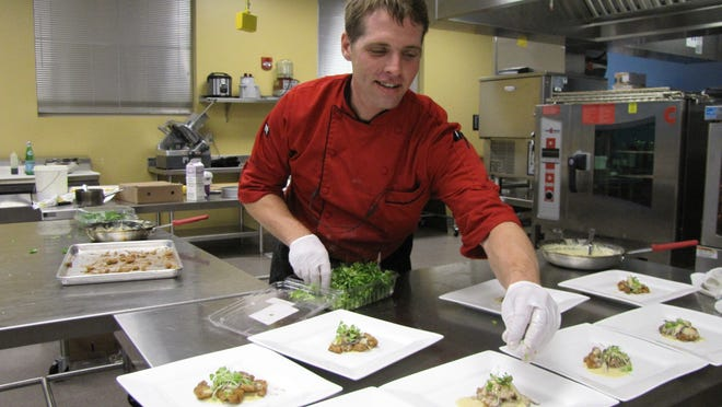 Paul Caricato of Bleu Provence adds the finishing touches to crisp sweetbreads with mushrooms and lemon cream sauce at the Wine Smackdown at the FGCU Wine Lab in 2014.