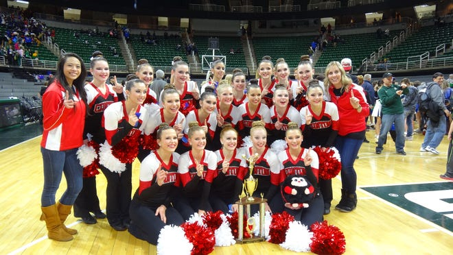 Canton's varsity pom squad celebrates winning the state championship Feb. 8 in Lansing. Pictured are: (front row, from left) Tara Quigley, Gabby Watts, Madison Santori, Katie Valchine and Ayden Peters; (second row, from left) Maigan Byars, Micala Tafelski, Grace Brekke, Abby Crippes, Stacey Partain, Aleigh Gorham, Mia Tavian and head coach Jenny Kesler; (third row, from left) assistant coach Gabby Cayao, Emma Stephens, Emily Cesario, Brenna Shaw, Sophia Mekled, Alicyn Mabry, Shelby Petersen, Morgan Filmore and Clara Mason. Not pictured are junior varsity coaches Brandee Amick and Nikki Battaglia.