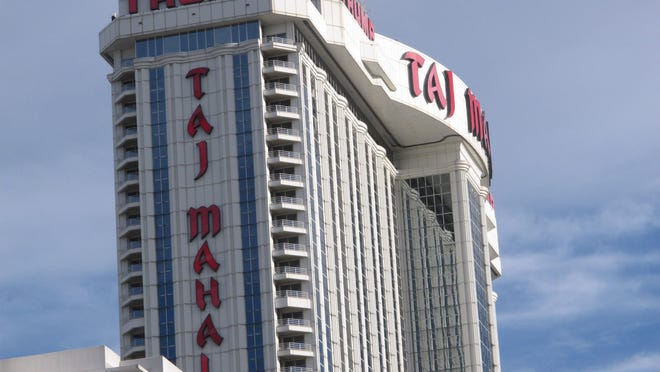 This Oct. 24, 2014 photo shows the exterior of the Trump Taj Mahal Casino resort in Atlantic City. The partial collapse of Atlantic City's gaming economy might be a big drag on southern New Jersey, and depress the incomes of Ocean County residents whose jobs were tied to the city.