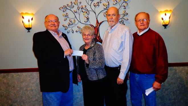 The Mountain Home Elks Lodge No. 1714 recently donated $1,000 to the local Backpack Food 4 Kids program. Shown are, from left, Stu Friend, Elks president; Marti and John Gilbert, co-directors of the Backpack program; and Butch Holligan, Elks grant coordinator.