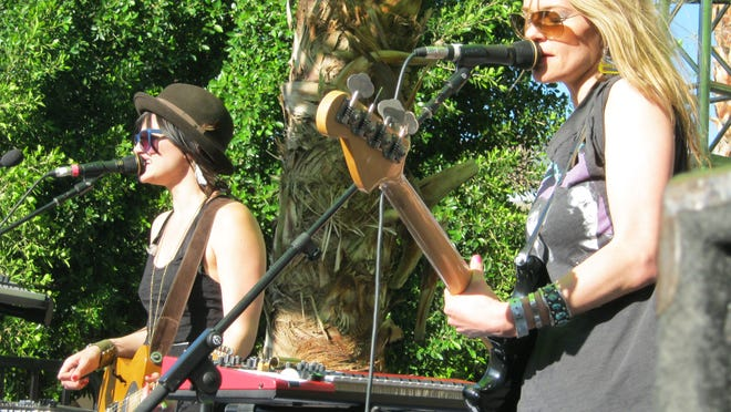 FILE - Indie duo Uh Huh Her headlined a pool party at the Riviera.