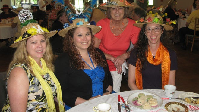 From left, Mary Sabia of Hyde Park, Monique Folchetti of Poughkeepsie, Val Brown of Poughkeepsie and Anne Pienciak of Boulder, Colo., show off their homemade hats Sunday at a Mother's Day high tea at Locust Grove historic site in Poughkeepsie.