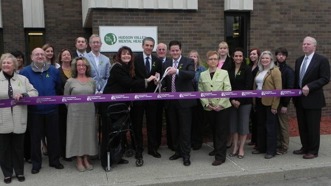 Ulster County Commissioner of Health and Mental Health Dr. Carol Smith, Hudson Valley Mental Health President Kevin Hazucha and Ulster County Deputy County Executive Kenneth Crannell are joined by the Hudson Valley Mental Health transition team and other professionals at a recent ribbon-cutting ceremony.