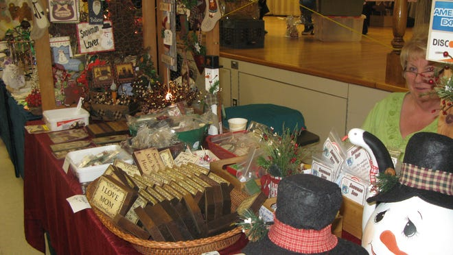Vendor Judy Hasbrouck of Starberry Country Treasures sits at her table at the St. Joseph's Church Holiday Craft Fair in New Paltz