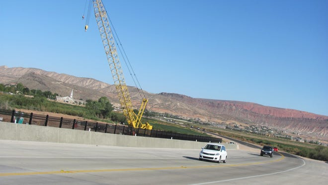 Motorists cross the newly-opened Mall Drive Bridge, a new connection between communities in St. George and Washington City, on Sunday.