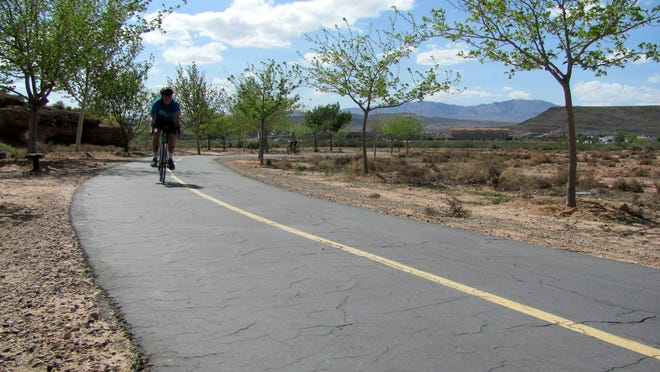 Cyclists head down a paved trail in St. George near the St. James Trailhead, one of several areas set to see new facilities as part of funding approved Thursday by the city council.