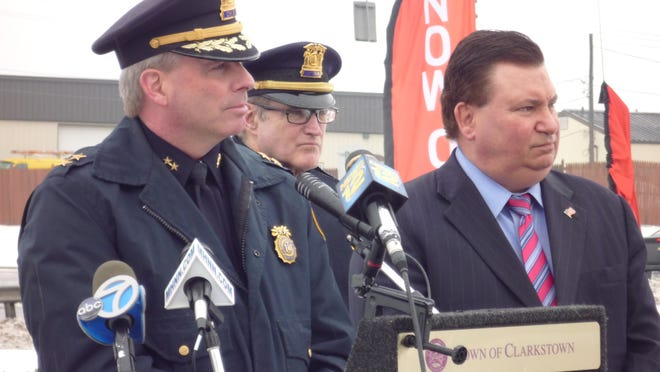 From left to right, Police Chief Michael Sullivan, Capt. Robert Mahon and Supervisor Alex Gromack hold a press conference announcing Gromack's proposal for $94.5 million in state funding to boost police coverage at large malls around the state.