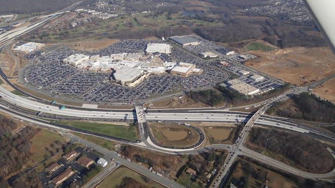 A 2013 aerial of Christiana Mall shows the Cavaliers golf course just beyond the parking lot.