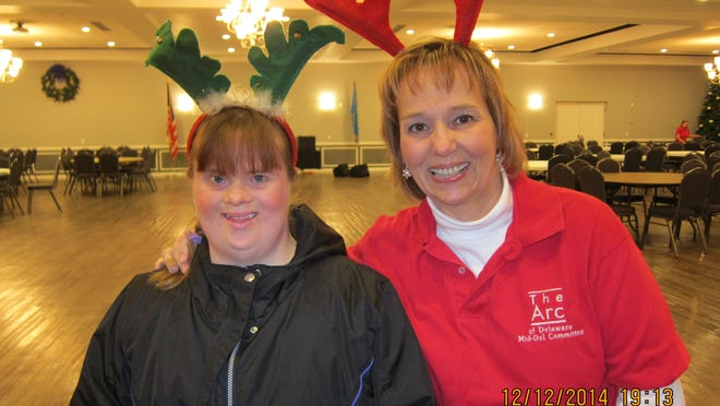 Arlissa Garret and mom Brenda Wilson, who serves on the Mid-Del Committee of the Arc of Delaware, get ready for the dance Dec. 12.