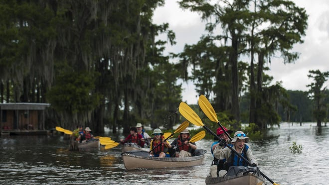 The troop paddles along Evangline Area Council's Swamp Base kayak trek which takes them on a sixty-mile path through the basin.