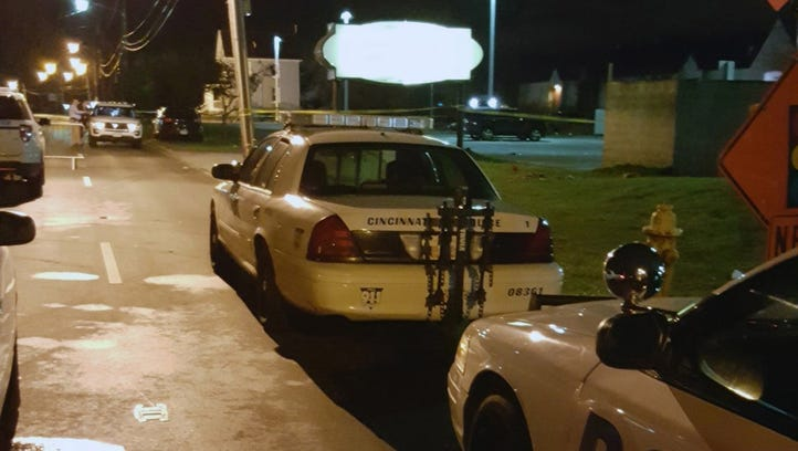 Cincinnati Police vehilces respond  to a shooting at
