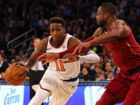 New York Knicks point guard Frank Ntilikina (11) drives against Cleveland Cavaliers shooting guard Dwyane Wade (9) during the fourth quarter at Madison Square Garden.