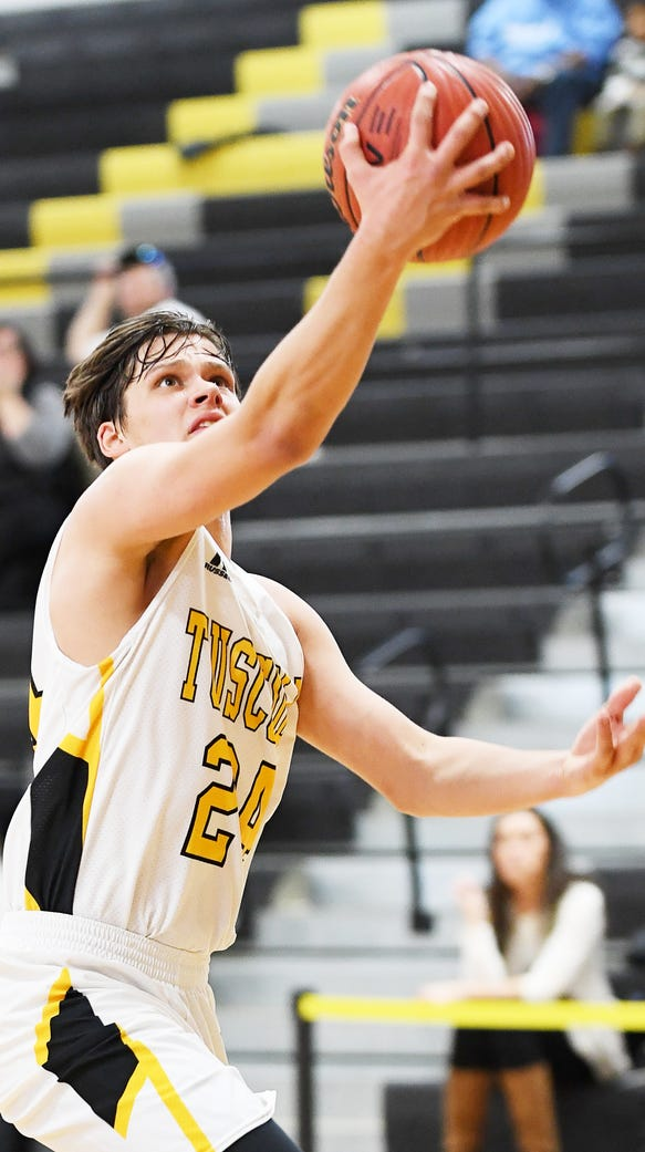 Tuscola's Lane Kervin shoots a layup in the Holiday
