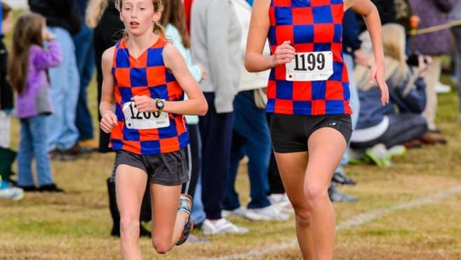 Jessie Crowley, left, Cate Ambrose and the Riverside girls will be after their third straight Class AAA championship at Saturday's state meet.