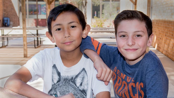 Fifth-graders Josiah Barrera, left, and his best friend Max Miller hang out in the courtyard of Highland Elementary School in Las Cruces on Friday, Nov. 3, 2017. Josiah saved his friend's life at lunch the previous day by performing the Heimlich Maneuver on his choking friend. Gary Mook/ for the Sun-News