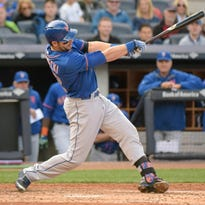 New York Mets' Kevin Plawecki hits a two-run home run during the fourth inning of an interleague baseball game against the New York Yankees Saturday, April 25, 2015, at Yankee Stadium in New York.