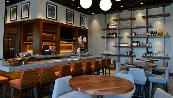 The Westin's Estelle Wine Bar and Bistro offers American cuisine and local alcohol from Cathead Distillery.