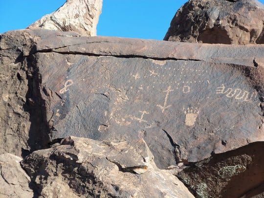 An extensive petroglyph panel sits at Little Black Mountain Petroglyph Site in Arizona.
