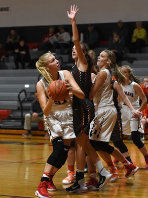 Rosecrans' Abby Hutcheson works beneath the basket against Meadowbrook on Wednesday.