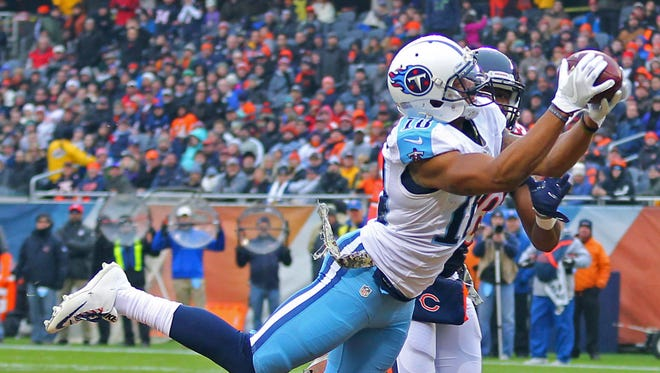 Titans wide receiver Rishard Matthews (18) catches a 29-yard touchdown pass over Chicago Bears free safety Adrian Amos (38) on Nov. 27, 2016.