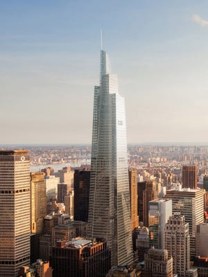 In this artist's rendering provided by BerlinRosen for SL Green Realty Corp., One Vanderbilt, center, rises above midtown Manhattan in New York. City officials cleared the way on Wednesday, May 27, 2015, for construction of the new, 65-story Manhattan skyscraper after the developer made an unusual tradeoff: a promise to make sweeping upgrades to nearby Grand Central Terminal that would allow more rush-hour trains on the subway's busiest lines and easier access from commuter trains to the subway.