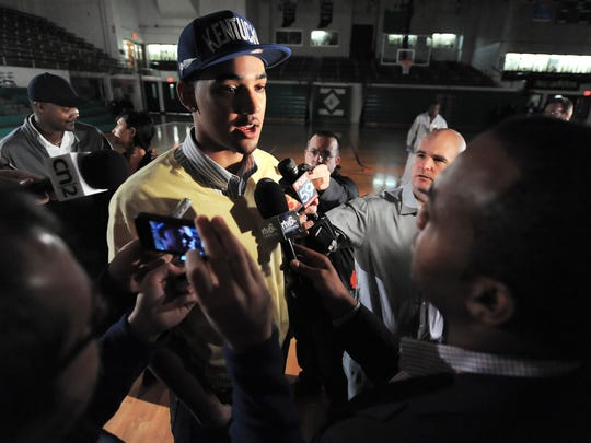 Five-star Indianapolis power forward Trey Lyles answers questions from the media while wearing a Kentucky hat after his college announcement at Tech High School Nov. 5, 2013.
