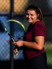 Henderson County's Kally Priest (pictured) smiles during