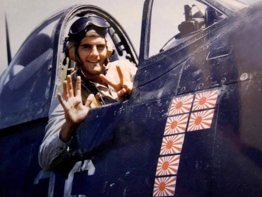 A young Jerry O'Keefe sits in his F4U Corsair. The