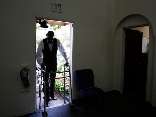 Jamie Nieto enters the church with the help of a walker for his wedding.