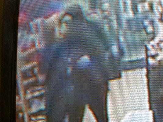 Surveillance image from Gasby's robbery.