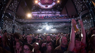 Music fans cheer on the rotating cast of local musicians at last year's Shine A Light concert at World Cafe Live at the Queen in Wilmington last year.
