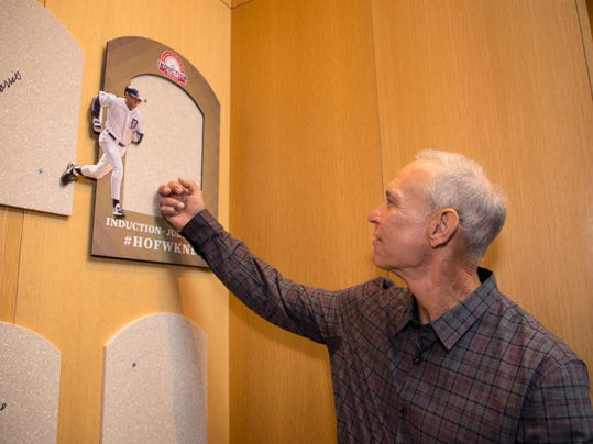 In this photo provided by the National Baseball Hall of Fame and Museum, inductee Alan Trammell touches the spot where his plaque will be located as he tours the Plaque Gallery, Thursday, March 15, 2018 at the National Baseball Hall of Fame and Museum in Cooperstown, N.Y. The former Detroit Tigers star will be inducted into the hall in July 2018. (Milo Stewart Jr./National Baseball Hall of Fame and Museum via AP)