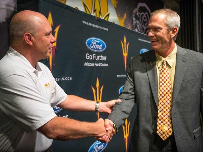 Arizona State University basketball coach Herb Sendek welcomes new ASU baseball coach Tracy Smith following Smith's introduction on Thursday, June 26, 2014. The two previously coached at the same time at Miami University of Ohio.