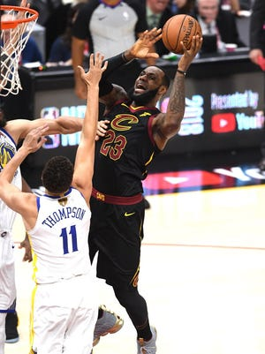 LeBron James of the Cleveland Cavaliers attempts a layup against the Golden State Warriors in the first quarter during Game 3.