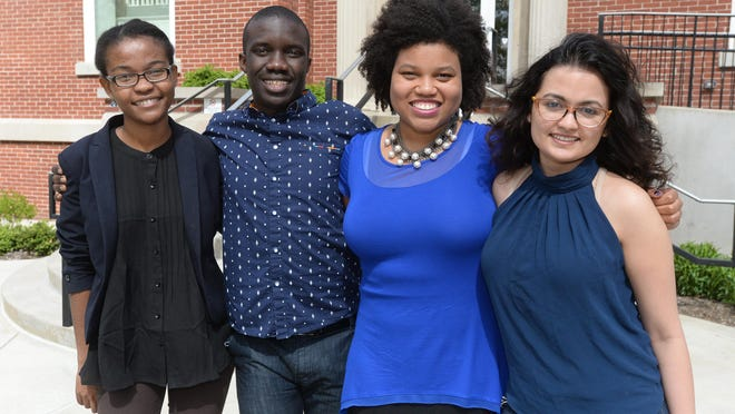 Earlham College students Leslie Ossete, Wyclife Omondi, Iman Cooper and Sonia Kabra are Team Magic Bus.