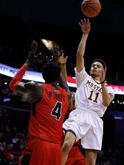 Missouri State's Jarred Dixon floats a shot against