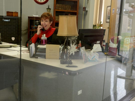 Crockett County High School front desk receptionist Sandy Woodruff answers the phone Friday, on her first day back at the school after a tornado caused damage Tuesday.