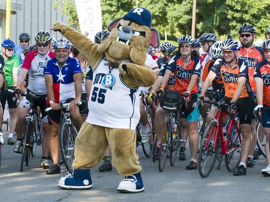 Butler University's mascot posed at the starting line with riders in the first 24 Hours of Booty fundraiser. This year's event begins June 25. Riders will navigate a 3.5-mile course through the neighborhoods surrounding the Butler campus.