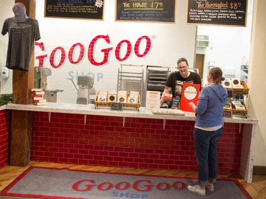 From left, pastry chef Bethany Halliger chats with manager Amanda Moore at the Goo Goo Shop's Candy Making Kitchen.