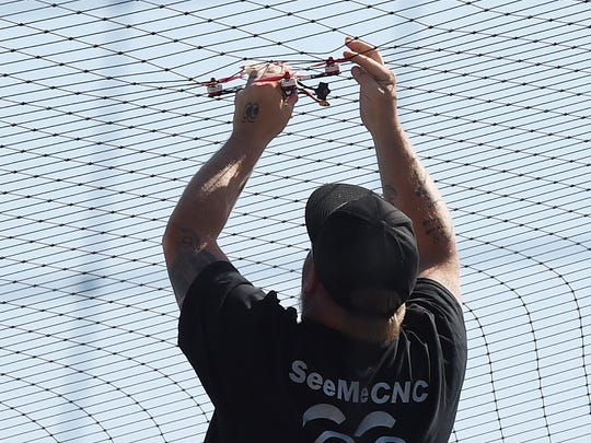 A drone is rescued from the net as Teams from the International Drone Racing Association held their event at Dover International Speedway on Sunday June 4th before the start of the 48th Annual AAA 400 Drive for Autism Race held at the speedway.