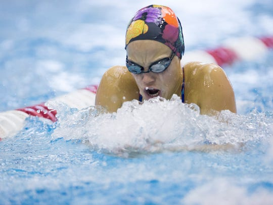 Alex Bader swims laps during practice Monday afternoon