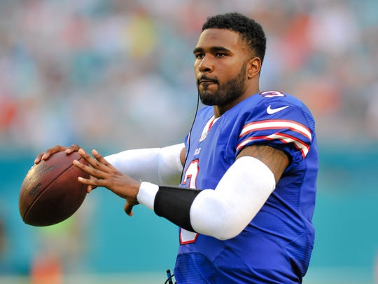EJ Manuel (3) warms up before the Dolphins game earlier this year.