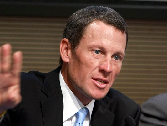 Lance Armstrong returns to competition as a swimmer