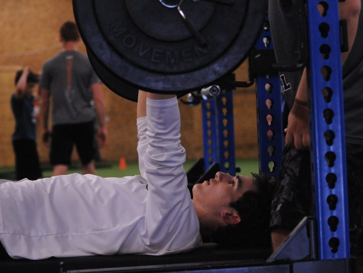 Asher Amey takes part in the bench press at The Athlete