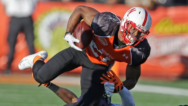 Nebraska running back Ameer Abdullah, top, runs the ball in the first half during the Senior Bowl in Mobile, Ala.