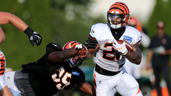 Cincinnati Bengals defensive tackle Andrew Billings breaks through the offensive line to tackle  running back Joe Mixon behind the line of scrimmage during training camp practice on Friday.